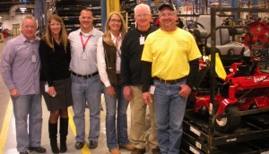 Brian and Gene Coe (at right) stand with Brian's new Lazer Z, which is ready to ship off to him in TN. The Coes are standing with Exmark General Manager, Judy Altmaier; Director of Marketing, Daryn Walters; Associate Marketing Manager, Katie Tauer and Marketing Manager, John Cloutier.