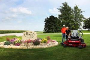 Farm Beautiful contest grand prize winner, Richard Haas, poses with his wife and their new Exmark Lazer Z X-Series mower.