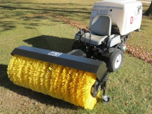 The rotary broom attachment expands the usefulness of the Navigator well beyond the cutting season.