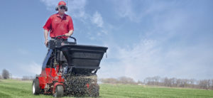 Spreader Attachment for Stand-on Aerator Improves Profitability