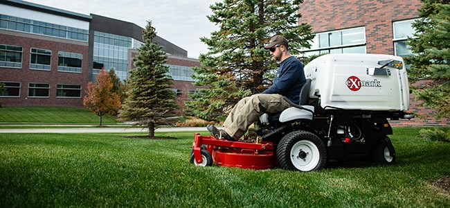 Exmark Navigator, a performance mower with RED technology and EFI, mowing an office campus