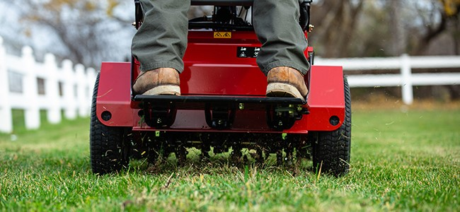 lawn aeration with an Exmark stand-on aerator